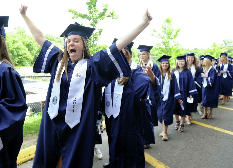 Graduate Cara McNiff celebrates during the Staples High School commencement ceremony Friday, June 20, 2014 at the school in Westport, Conn. Photo: Autumn Driscoll / Connecticut Post