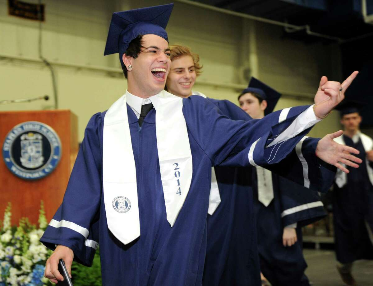 Graduate Daniel Fishkind points to a friend during the Staples High School commencement ceremony Friday, June 20, 2014 at the school in Westport, Conn.