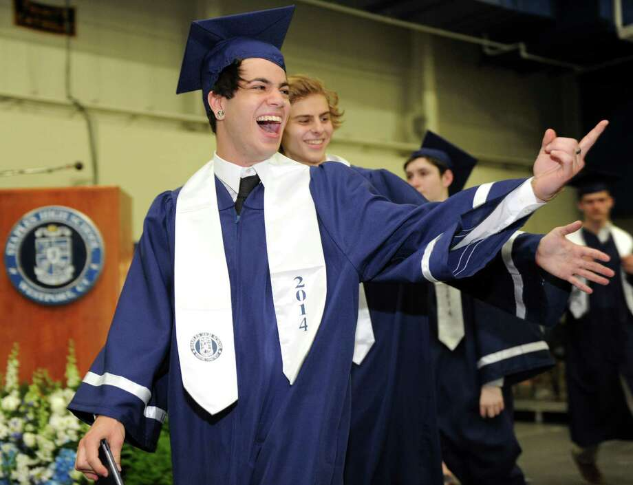 Graduate Daniel Fishkind points to a friend during the Staples High School commencement ceremony Friday, June 20, 2014 at the school in Westport, Conn. Photo: Autumn Driscoll / Connecticut Post