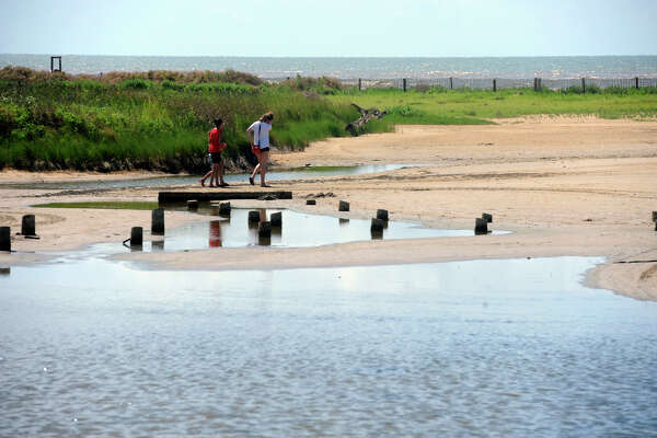 Guests walk near the marshes of Sea Rim State Park on Friday. Photo taken Guiseppe Barranco/@spotnewsshooter