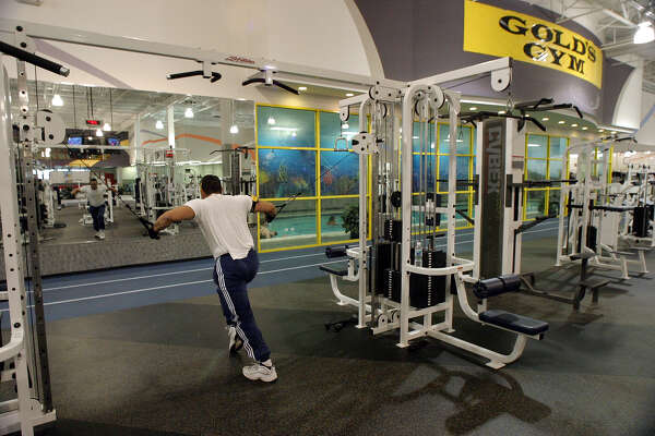 Gold's Gym recently bought out the Fitness Connection chain. We have a look at the new Gold's Gym on Goliad. Here, Josh Hernandez works out on the weight machines. ( PHOTO BY J. MICHAEL SHORT / SPECIAL )