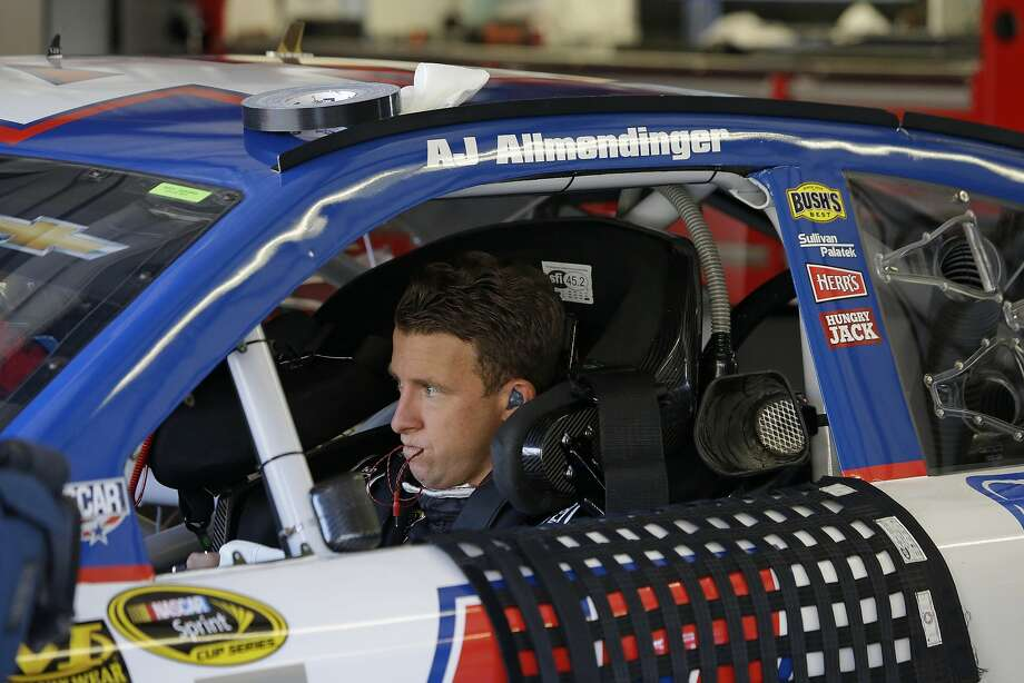 "Los Gatos native AJ Allmen- dinger, who says he found the old single-car qualifying ""kind of boring,"" waits for practice to begin at Sonoma Raceway. NASCAR's new knockout qualifying ""makes it exciting for the drivers,"" he says. Photo: Eric Risberg, Associated Press"