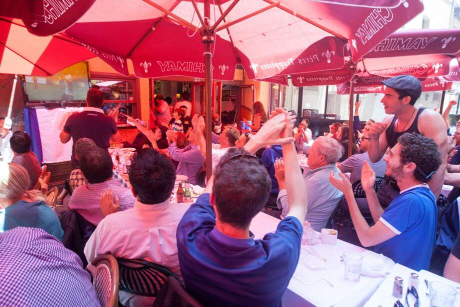 French soccer fans watch the France vs. Switzerland first round World Cup match at Cafe Bastille in San Francisco, CA. Photo: Douglas Zimmerman, Courtesy
