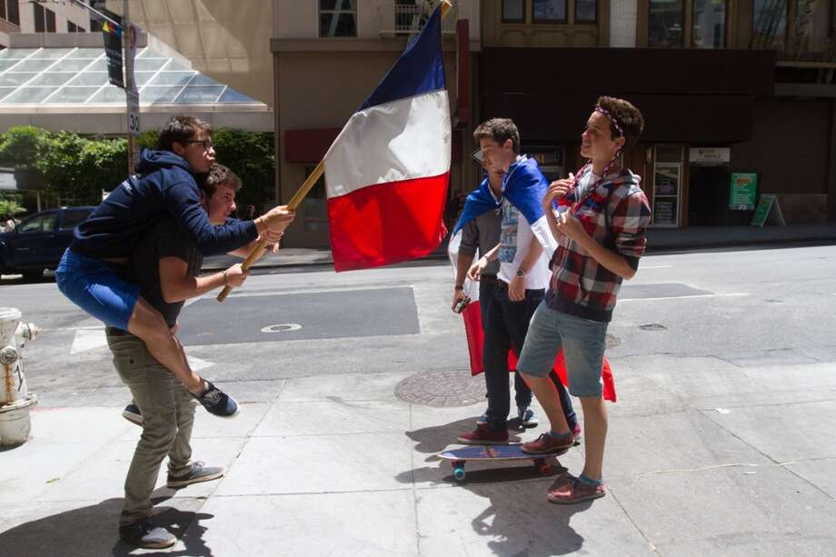 French soccer fans (left to right) Tom Damagnez, Louis-Pierre Guidetti, Pierre Bourguignon,  Baptiste Gaertner, and Timon Vicat  hang out after watching the France vs. Switzerland first round World Cup match at Cafe Bastille in San Francisco, CA. Photo: Douglas Zimmerman, Courtesy