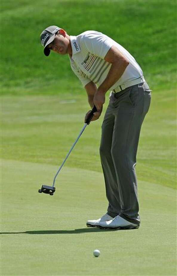 Brendan Steele watches his putt on the 18th hole during the second round of the Travelers Championship golf tournament in Cromwell, Conn., Friday, June 20, 2014. (AP Photo/Fred Beckham)