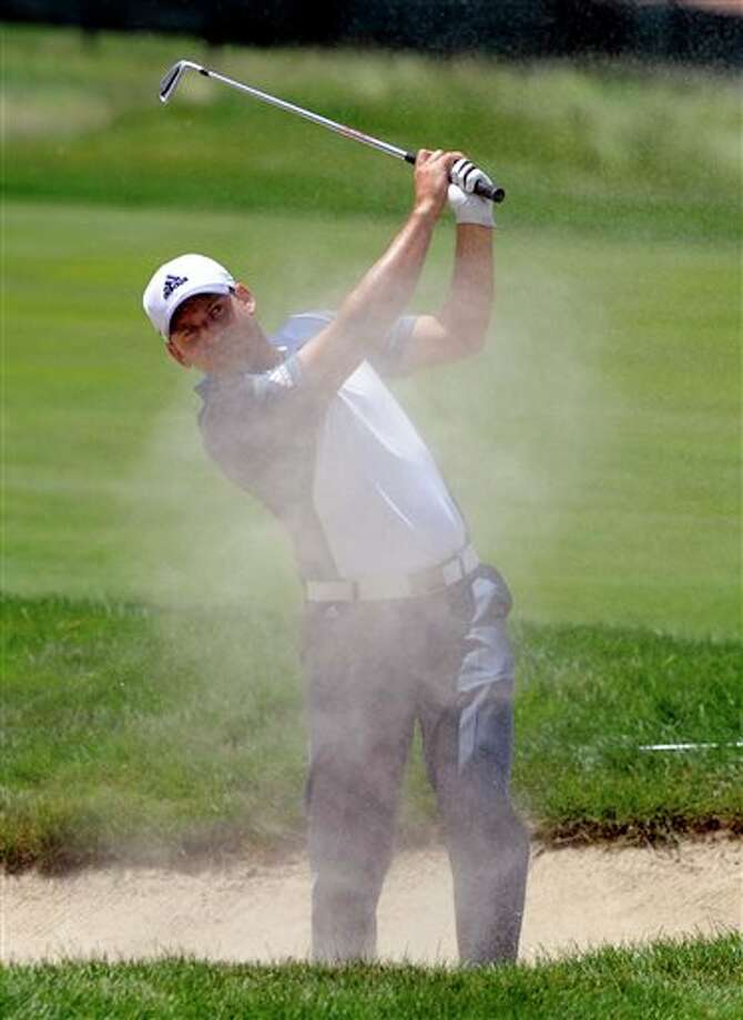 Sergio Garcia, of Spain,  watches his shot after hitting out of a fairway bunker on the seventh  hole during the second round of the TravelersChampionship golf tournament in Cromwell, Conn., Friday, June 20, 2014. (AP Photo/Fred Beckham)