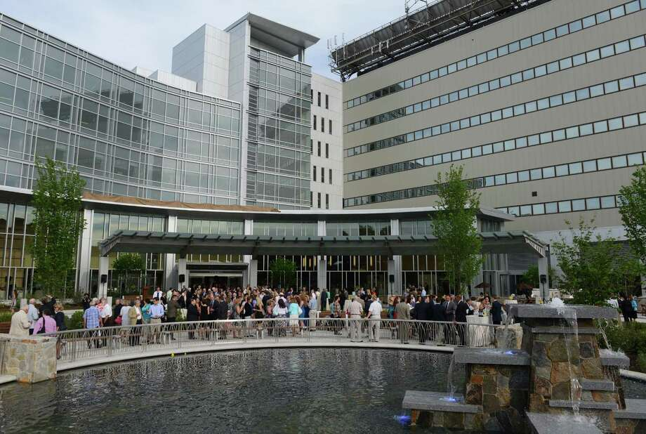 Guests mingle during the dedication party and ribbon-cutting for the new Peter and Carmen Lucia Buck Pavilion addition to the Danbury Hosptial in Danbury, Conn. Friday, June 20, 2014.  Subway founder and Danbury resident Peter Buck donated $30 million toward the $150 million, 11-story addition to the hospital.  The new addition features an expanded lobby entrance, state-of-the-art 30-bed critical care unit, 35-bed floor for surgical patients, expanded parking garage and the Anna-Maria and Stephen Kellen Emergency Department, which will double the size of the hospital's old and overcrowded emergency room. Photo: Tyler Sizemore / The News-Times
