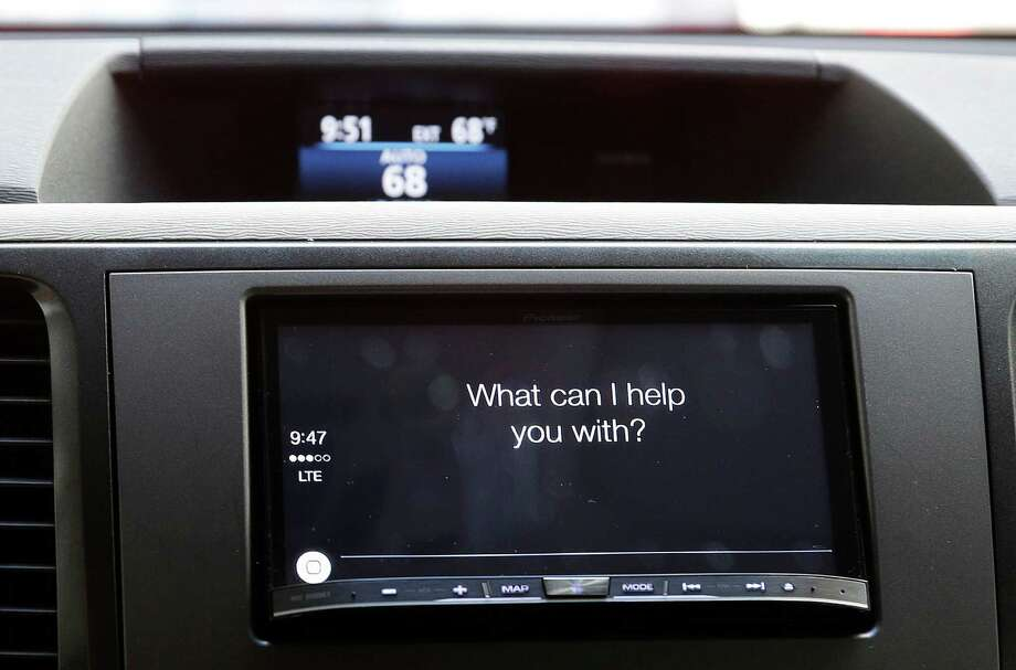 Apple CarPlay asks a driver a question during a demonstration in San Francisco. Photo: Eric Risberg / Associated Press / AP