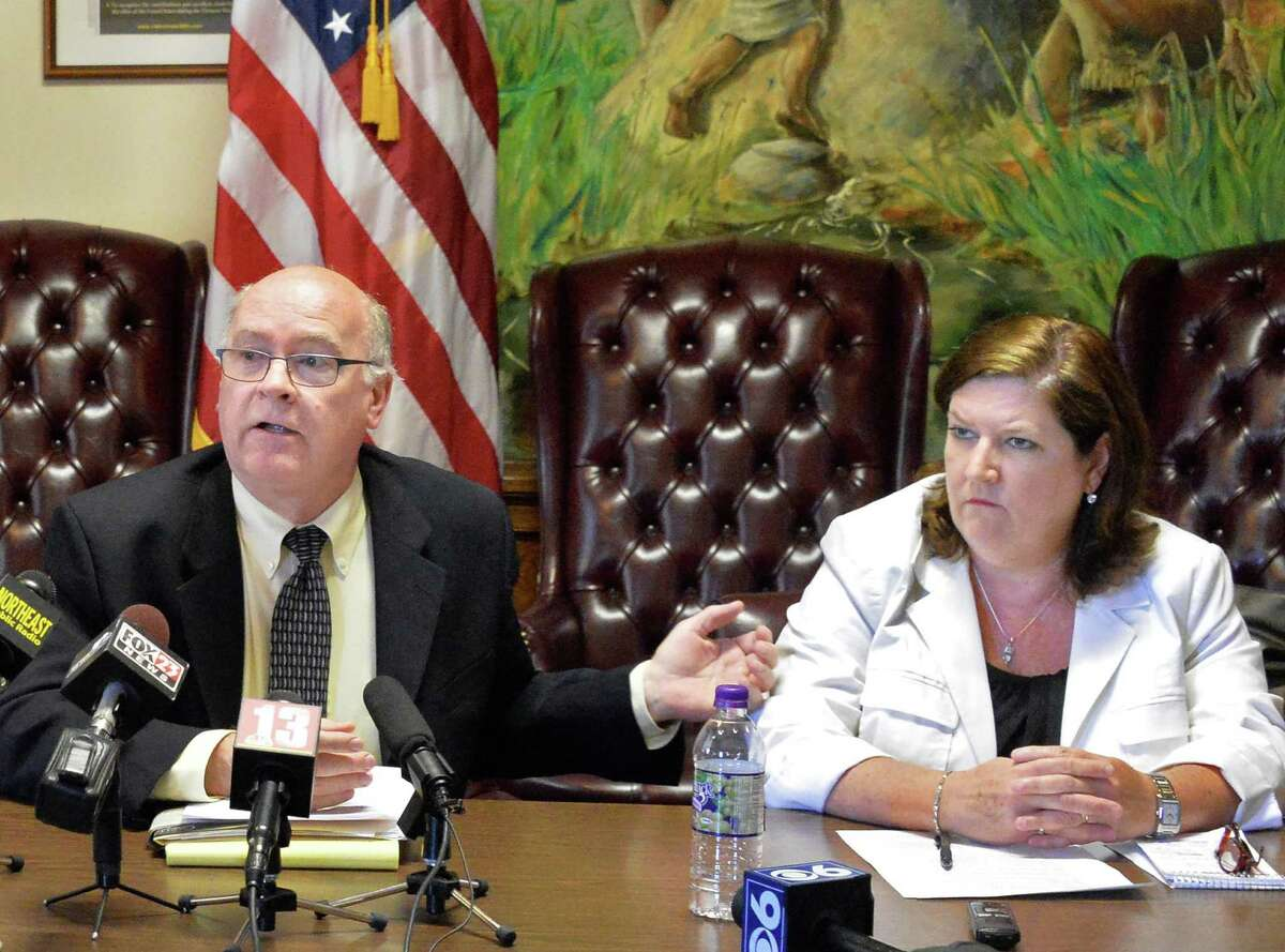 Saratoga Springs Public Safety Commissioner Chris Mathiesen, left, and Deputy Commissioner Eileen Finneran answer questions relating to the Darryl Mount Jr. case during a news conference at City Hall Friday June 20, 2014, in Saratoga Springs, NY. Finneran will primary for Commissioner of Public Safety. (John Carl D'Annibale / Times Union)