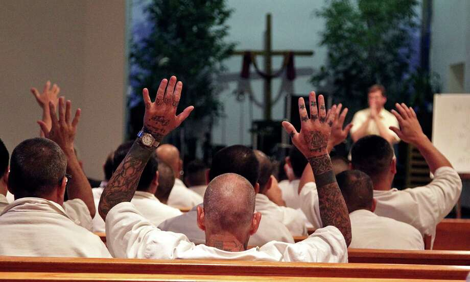 Prison inmates attended a Woodhaven Baptist Deaf Church Prison Ministry sermon on June 12 in Riverside. Photo: James Nielsen, Staff / © 2014  Houston Chronicle