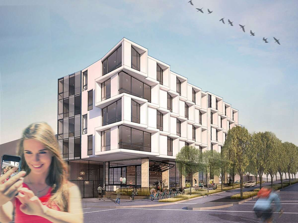 Now a parking lot, the southeast corner of Octavia Boulevard and Page Street has been awarded to a development team that plans to build 26 condominums, four of theme affordable, along street-level retail spaces.