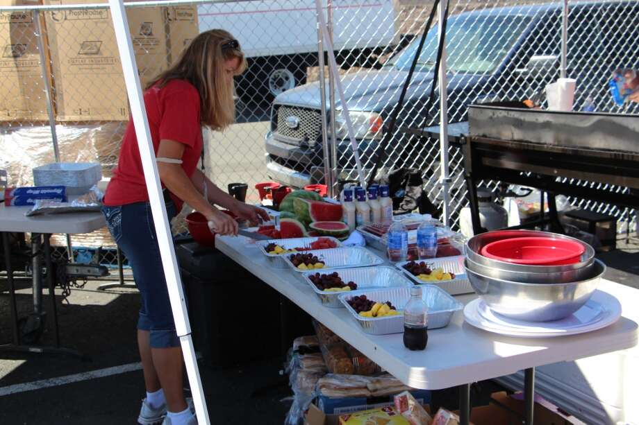 Setting out fruit plates at the Rousch Performance Parts Ford tent.