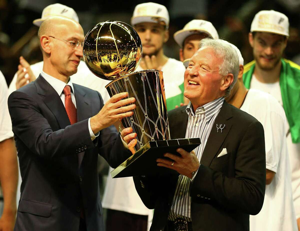 SAN ANTONIO, TX - JUNE 15: San Antonio Spurs owner Peter Holt celebrates with the Larry O'Brien trophy after defeating the Miami Heat to win the 2014 NBA Finals at the AT&T Center on June 15, 2014 in San Antonio, Texas. NOTE TO USER: User expressly acknowledges and agrees that, by downloading and or using this photograph, User is consenting to the terms and conditions of the Getty Images License Agreement.