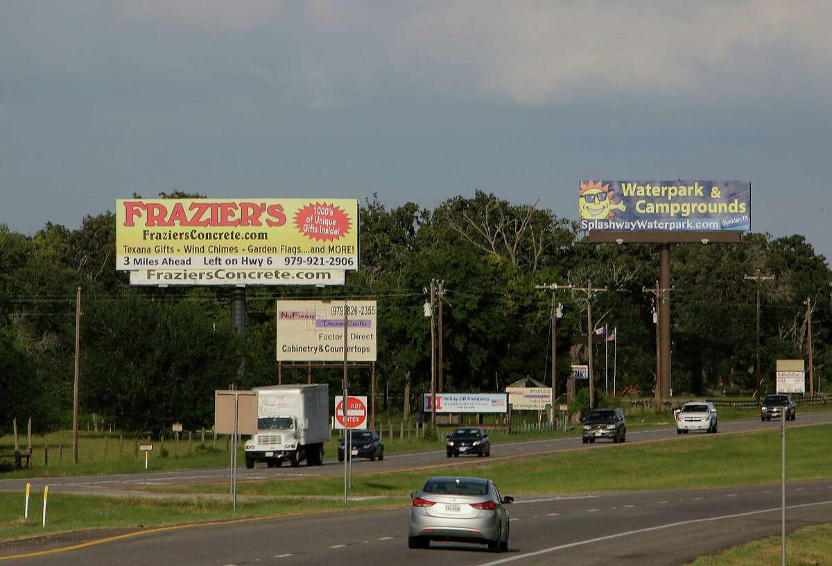 Advertising billboards along U.S. 290 on June 20, 2014, near Hempstead. State laws control billboards along highways, though an appeals court last week struck down core parts of the law.