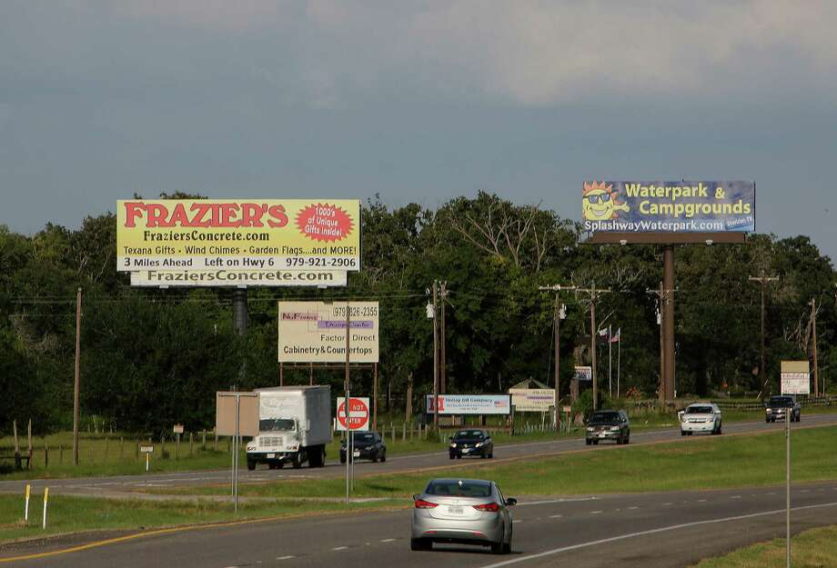 Advertising billboards along U.S. 290 on June 20, 2014, near Hempstead. State laws control billboards along highways, though an appeals court last week struck down core parts of the law. Photo: James Nielsen, Houston Chronicle / © 2014  Houston Chronicle