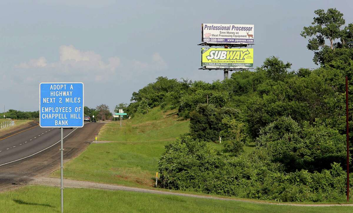 Advertising billboards along U.S. 290 on June 20, 2014, in Chappell Hill. Changes would keep Texas' prohibition on most billboards in place, despite a court challenge.