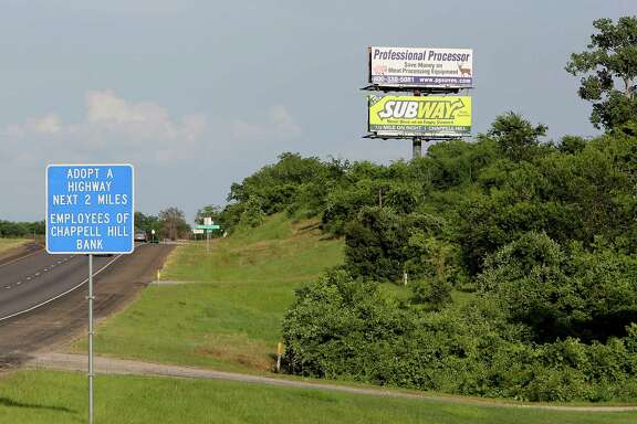 Advertising billboards along US Highway 290 Friday, June 20, 2014, in Chappell Hill.