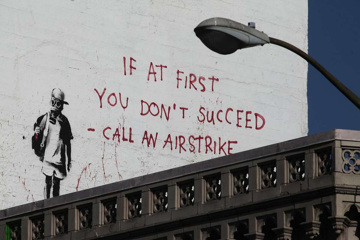 A banksy piece looms over the corner of Columbus Ave. and Broadway St. in San Francisco, Calif. on Thursday, June 19, 2014. San Francisco is home to several Banksy pieces.