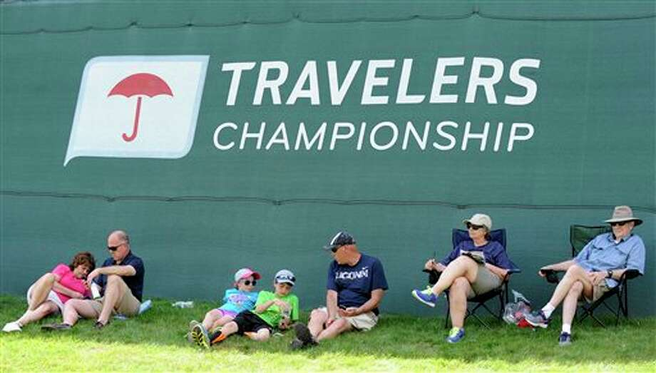 Spectators watch the action on the 18th hole during the second round of the Travelers Championship golf tournament in Cromwell, Conn., Friday, June 20, 2014. (AP Photo/Fred Beckham)
