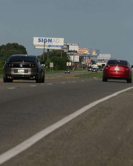 Billboards clutter the side of U.S. 290 near Hempstead. A proposal would raise the maximum height of Texas highway signs to 65 feet, taller than a six-story building. Photo: James Nielsen, Staff / © 2014  Houston Chronicle