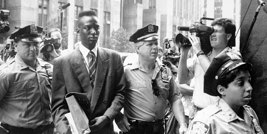 "FILE - This 1990 file photo provided by Sundance Selects shows accused rapist Yusef Salaam, second right, being escorted by police in New York in 1990. Salaam is the subject of the documentary, ""The Central Park Five,"" about the 1989 case of five black and Latino teenagers who were convicted of raping a white woman in Central Park. A city official said Friday, June 20, 2014 that New York City has agreed to a $40 million settlement in a civil rights lawsuit filed against police and prosecutors by Salaam and four co-defendants exonerated in the notorious case of a jogger attacked in Central Park in 1989. (AP Photo/Sundance Selects, NY Daily News, File) ORG XMIT: NYR104 Photo: Clarence Davis / New York Daily News via Sundance Selects Films"