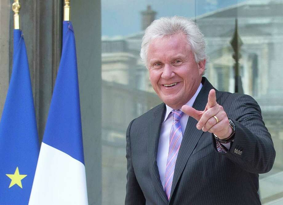 General Electric Co. CEO Jeffrey R. Immelt, gestures as he leaves the Elysee Palace after a meeting with French President Francois Hollande at the Elysee Palace, Friday, June 20, 2014. The international race to take over France's engineering company Alstom SA entered its final stretch on Friday, with Siemens and Mitsubishi Heavy Industries responding to General Electric Co.'s sweetened bid by raising their own combined offer. (AP Photo/Michel Euler) ORG XMIT: MEU106 Photo: Michel Euler / AP