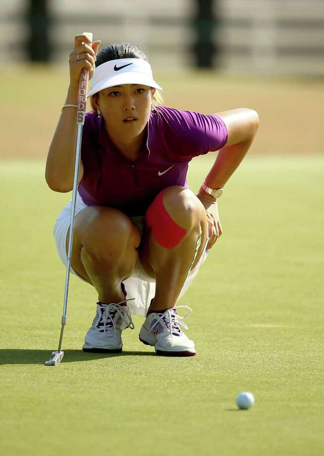 PINEHURST, NC - JUNE 20:  Michelle Wie of the United States lines up a putt on the 13th hole during the second round of the 69th U.S. Women's Open at Pinehurst Resort & Country Club, Course No. 2 on June 20, 2014 in Pinehurst, North Carolina.  (Photo by Streeter Lecka/Getty Images) ORG XMIT: 461933945 Photo: Streeter Lecka / 2014 Getty Images