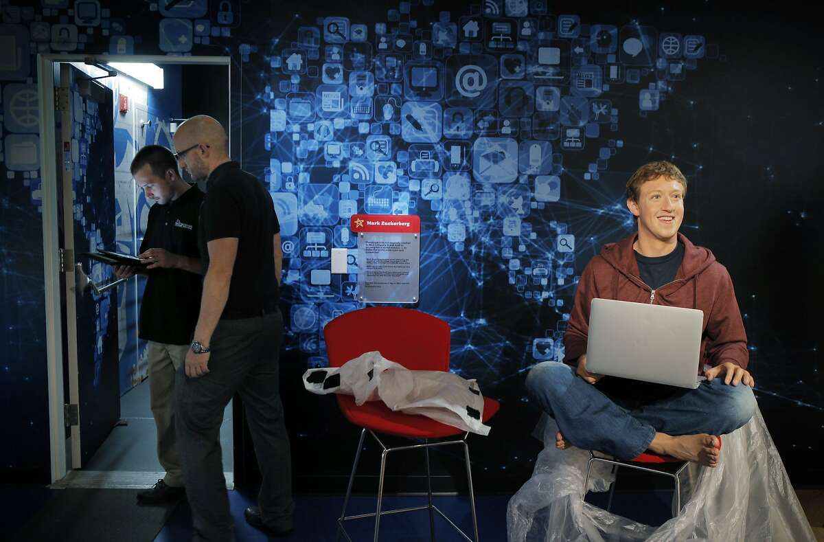 Workers at Madame Tussauds finish preparations at the museum near a wax figure of Mark Zuckerberg on Monday, June 16, 2014. Madame Tussauds is about to open at Fisherman's Wharf in San Francisco, Calif., and preparations are underway for the opening in the upcoming days.