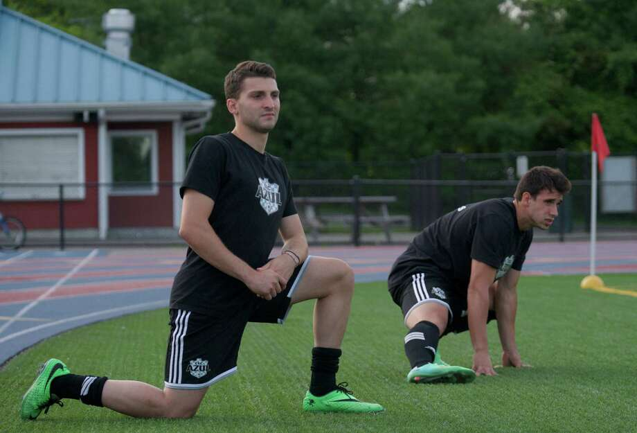 Raphael Carralho, left, and Raphael Maura, both from Danbury, stretch before going into the game for the CFC Azul during a USL Premier League Soccer game between the Portland Phoenix and the ,Connecticut based, CFC Azul, on Friday, June 20, 2014, played at Danbury High School, Danbury, Conn. Photo: H John Voorhees III / The News-Times Freelance