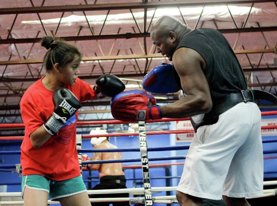 Ruth Diaz, left, spars with trainer Tim Knight at Savannah Boxing Club.  High-volume body blows and the left uppercut are the 16-year-old's top weapons. Photo: Bob Levey, Photographer / ©2014 Bob Levey