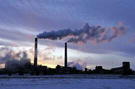 File-This Feb. 19, 2014, file photo shows the coal-fired Sherburne County (Sherco) Generating Plant, in Becker, Minn. Minnesota, which already successfully lowered carbon emissions and capitalized on renewable energy sources, must cut carbon dioxide emissions by nearly 41 percent over the next 15 years as part of a sweeping plan President Barack Obama announced Monday to reduce pollution from power plants. (AP Photo/St. Cloud Times, Jason Wachter, File)
