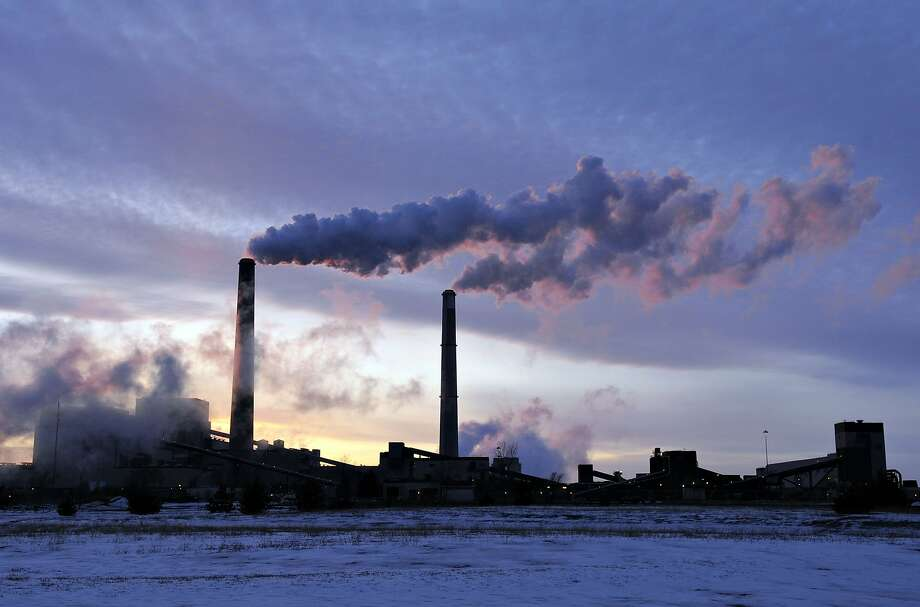 File-This Feb. 19, 2014, file photo shows the coal-fired Sherburne County (Sherco) Generating Plant, in Becker, Minn. Minnesota, which already successfully lowered carbon emissions and capitalized on renewable energy sources, must cut carbon dioxide emissions by nearly 41 percent over the next 15 years as part of a sweeping plan President Barack Obama announced Monday to reduce pollution from power plants. (AP Photo/St. Cloud Times, Jason Wachter, File) Photo: Jason Wachter, Associated Press