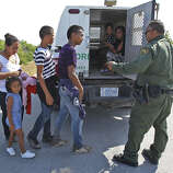 After being questioned, the members of a group of unauthorized immigrants discovered near Anzalduas Park southwest of McAllen are loaded into Border Patrol vehicles. The U.S. now plans to seek more detention facilities for families.