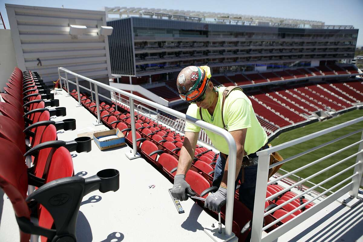 Michael Randel of Danny's Construction Company Inc. installs a comfort rail in front of a row of seats on the Bud Light Patio at the San Francisco 49ers new $1.2 billion Levi's Stadium in Santa Clara, CA, Tuesday June 17, 2014. The new venue will seat approximately 68,500 and will feature an expected 165 luxury suites and 8,500 club seats.