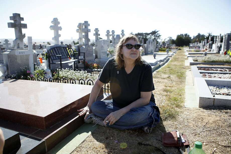 Roza Katovitch sits by the grave site of her boyfriend of 22 years at the Serbian Cemetery in Colma. Photo: Michael Short, The Chronicle