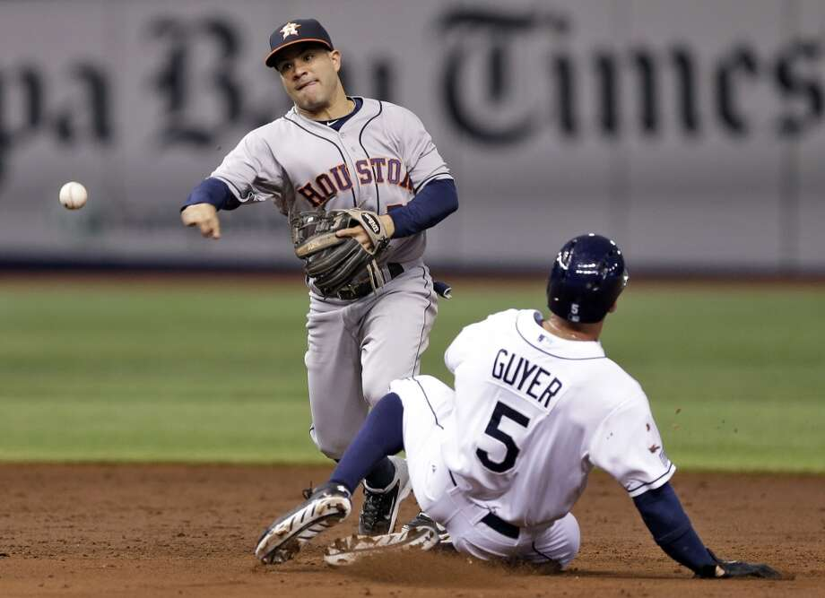 Jose Altuve forces Brandon Guyer at second base and relays the throw to first base to turn double play during the second inning. Photo: Chris O'Meara, Associated Press