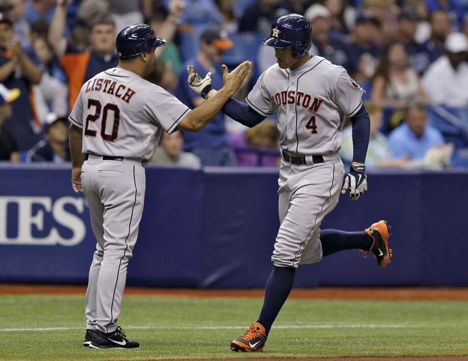 George Springer high fives third base coach Pat Listach after hitting a two-run home run during the third inning. Photo: Chris O'Meara, Associated Press