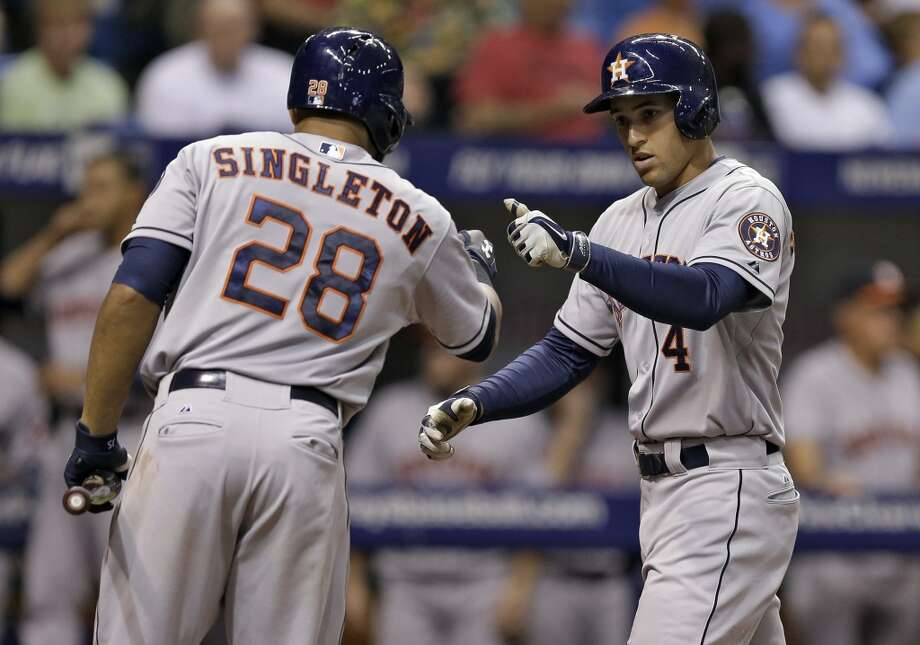 George Springer, right, celebrates with on-deck batter Jon Singleton after hitting a two-run home run during the third inning. Photo: Chris O'Meara, Associated Press