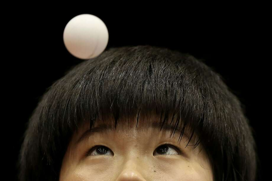 Lee Dasom of Korea serves against Hitomi Sato of Japan in their U21 Girls Singles match during day one of 2014 ITTF World Tour Japan Open at Yokohama Cultural Gymnasium on June 20, 2014 in Yokohama, Japan.  Photo: Chris McGrath, Getty Images