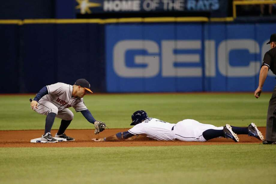 The Rays' Sean Rodriguez, right, fails to reach second base before the Astros' Jose Altuve applies the tag to thwart an attempted steal during the eight inning of Friday night's game. Photo: Scott Iskowitz, Stringer / 2014 Getty Images