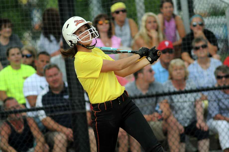 Yellow Team's River Ward sends the ball as she bats against the Blue Team during the 2nd Annual Deanna Marie Rivers (518) Memorial Softball Tournament on Friday, June 20, 2014, at the Christian Plumeri Sports Complex in Albany, N.Y. (Cindy Schultz / Times Union) Photo: Cindy Schultz / 00026816A