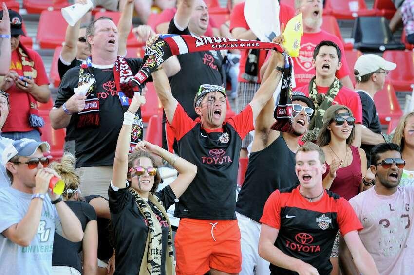 San Antonio Scorpions fans cheer during the first half of an NASL soccer game against the Ft. Lauderdale Strikers, Saturday, June 7, 2014, in San Antonio. (Darren Abate/NASL)