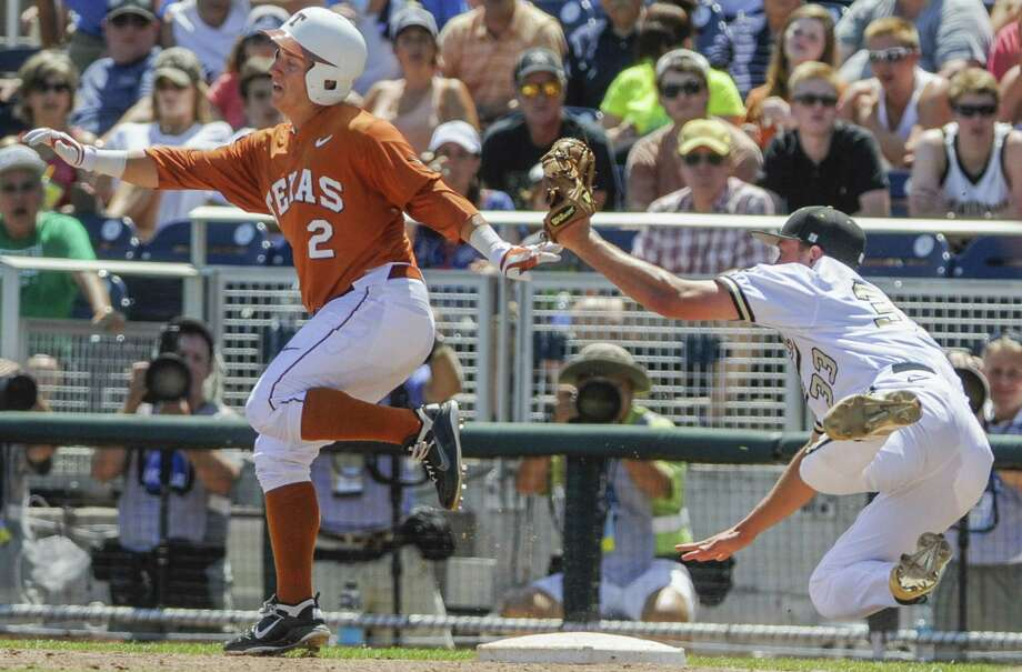 Texas' Mark Payton is safe at first as Vanderbilt pitcher Brian Miller stumbles in the second inning. Photo: Eric Francis / Associated Press / FR9944 AP