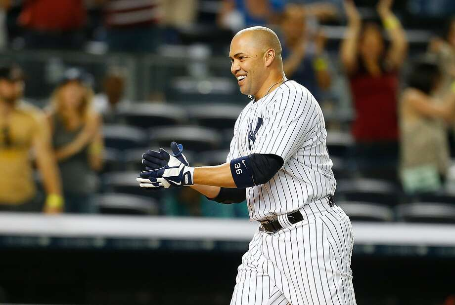 NEW YORK, NY - JUNE 20:  Carlos Beltran #36 of the New York Yankees celebrates after hitting game winning walk-off three run home run in the ninth inning against the Baltimore Orioles at Yankee Stadium on June 20, 2014 in the Bronx borough of New York City. Yankees defeated the Orioles 5-3.  (Photo by Mike Stobe/Getty Images) Photo: Mike Stobe, Getty Images