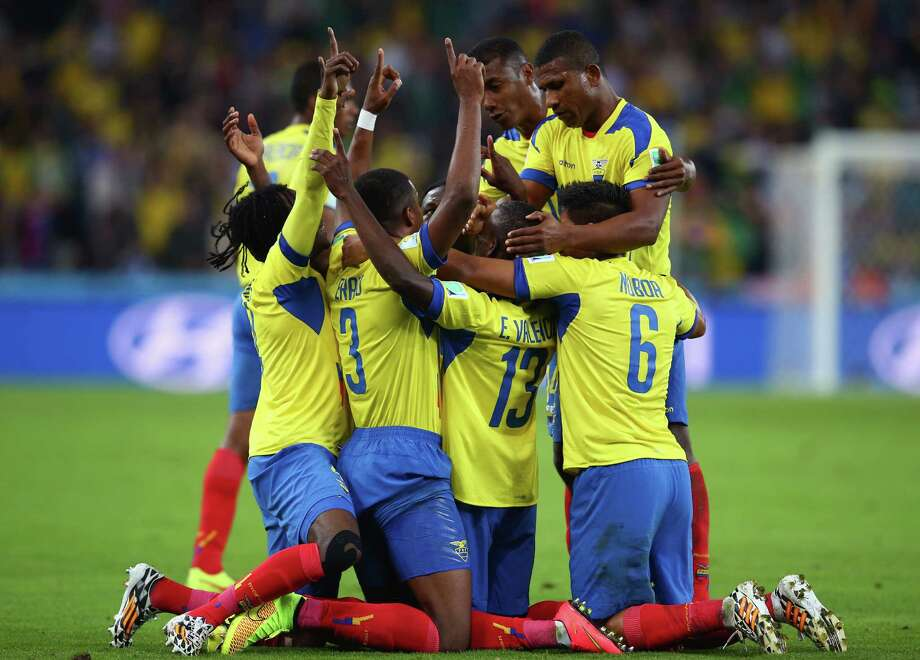 CURITIBA, BRAZIL - JUNE 20: Enner Valencia #13 of Ecuador celebrates with teammates after scoring his team's second goal during the 2014 FIFA World Cup Brazil Group E match between Honduras and Ecuador at Arena da Baixada on June 20, 2014 in Curitiba, Brazil.  (Photo by Julian Finney/Getty Images) *** BESTPIX *** Photo: Julian Finney, Getty Images / 2014 Getty Images