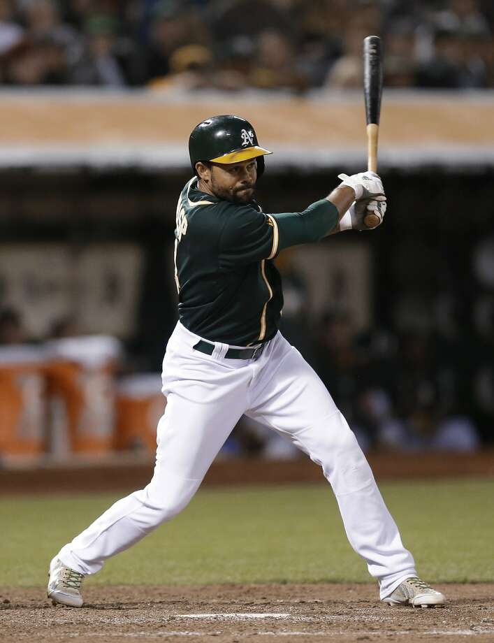 Oakland Athletics' Coco Crisp swings for an RBI single off Boston Red Sox pitcher Andrew Miller in the eighth inning of a baseball game Friday, June 20, 2014, in Oakland, Calif. (AP Photo/Ben Margot) Photo: Ben Margot, Associated Press