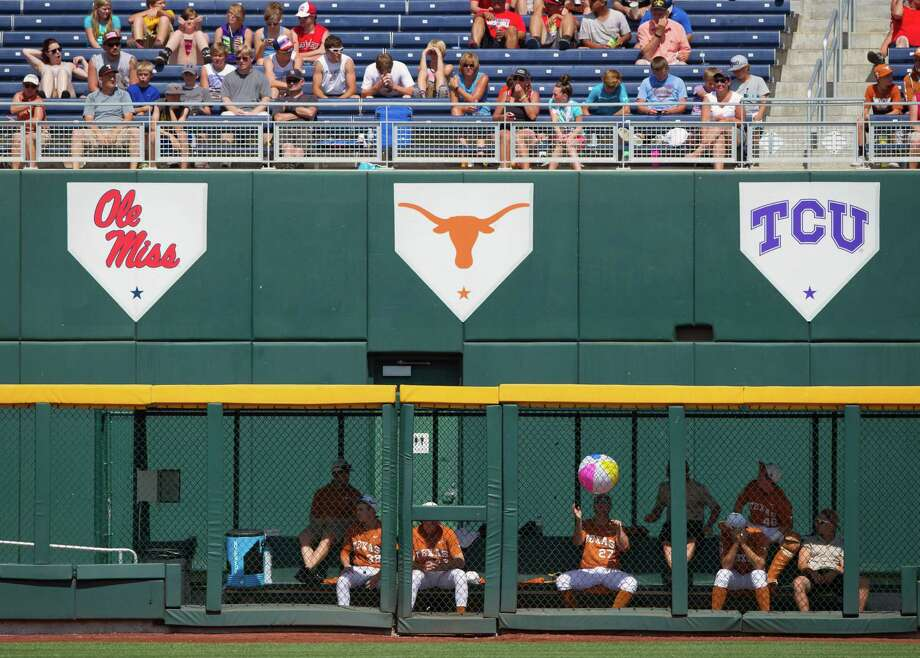 Players in the Texas bullpen amuse themselves with a beach ball in the fifth inning against Vanderbilt during an NCAA baseball game in the College World Series in Omaha, Neb., on Friday, June 20, 2014. (AP Photo/Omaha World-Herald, Ryan Soderlin) Photo: Ryan Soderlin, Associated Press / Omaha World-Herald