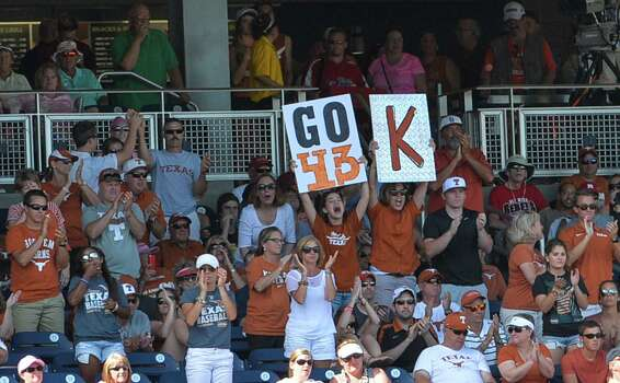 """Texas fans hold up a sign reading """"Go 43"""" in reference to Texas pitcher John Curtiss (43), during an NCAA  College World Series baseball game against Vanderbilt, in Omaha, Neb., Friday, June 20, 2014. (AP Photo/Ted Kirk) Photo: Ted Kirk, Associated Press / FR34398 AP"""