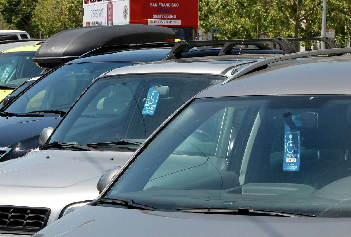 Disabled parking placards are displayed near Civic Center Plaza on Friday May, 17, 2013 in San Francisco, Calif.
