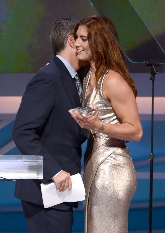 CENTURY CITY, CA - MAY 19:  Entertainment/Sports Agent Executive Casey Wasserman (L) hugs Pro soccer player and honoree Hope Solo as she walks onstage at the podium after receiving the Female Athlete of the Year award at the 28th Anniversary Sports Spectacular Gala at the Hyatt Regency Century Plaza on May 19, 2013 in Century City, California.  (Photo by Kevin Winter/Getty Images for Sports Spectacular)